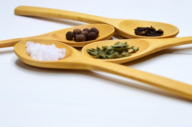 Salt, pepper and oregano on spoons